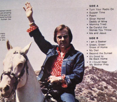 Gene Ewing record cover backside on a horse