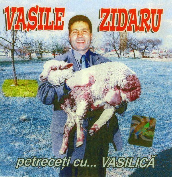 Romanian singer Vasile Zidaru holding a sheep.
